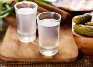 Typical Polish way to drink vodka is with one shot followed by a bite of pickled cucumber to wash it down