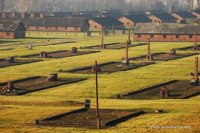 Aerial view on chimneys remaining after blown up gas chambers in Auschwitz Birkenau